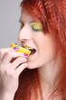 redhaired girl eating the lemon
