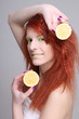portrait of redhaired woman with lemon