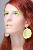 girl with lemon slices in ears dreaming