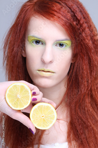 young attractive woman holding lemon
