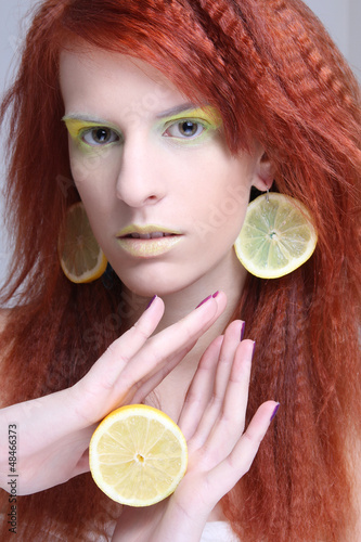 woman with lemon slices in ears