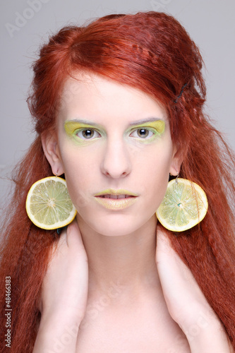 girl with lemon slices in ears