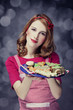 Redhead women with cookies