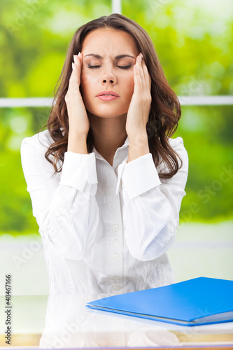 Thinking, tired or ill with headache business woman