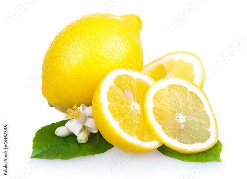 Yellow lemon fruits with leaves and slices isolated