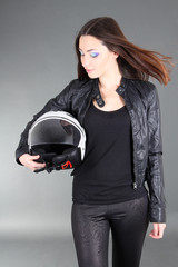 Young pretty woman with helmet in hands