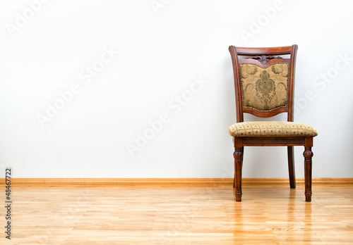Interior with classic chair on wooden floor