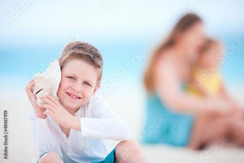 Cute boy with seashell
