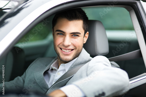Handsome man in his car