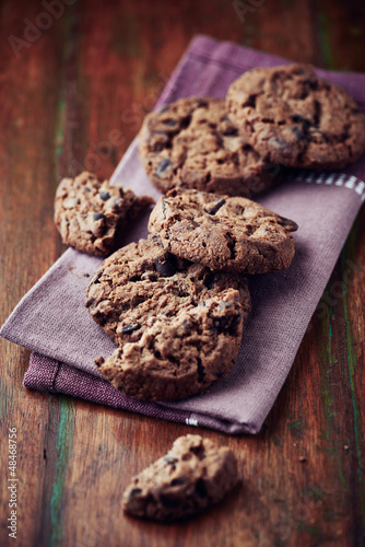 Dark chocolate chip cookies on a napkin