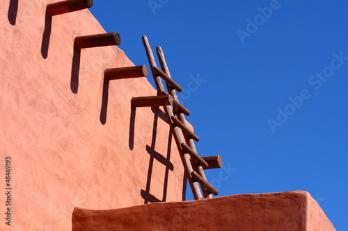 Wood Ladder on Adobe Wall