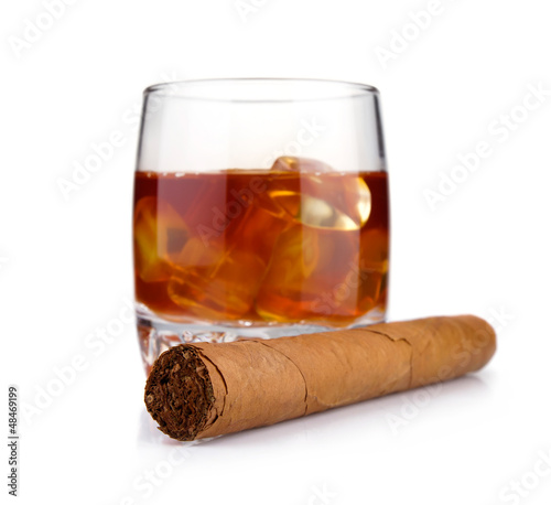 Cigar and glass of whiskey with ice concept isolated