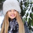 Beautiful woman portrait in winter - closep