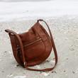 Brown purse on sand