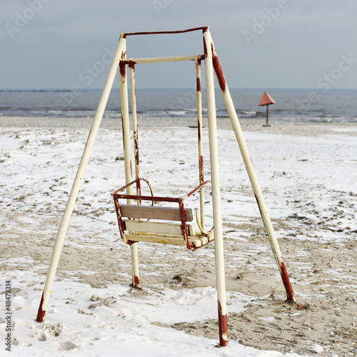 Old swing on the beach