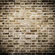 Grunge brick wall, square photograph with vignette