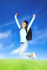 Young Girl Jumping with a Backpack