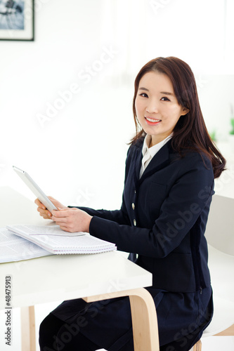 Young Asian student studying with pad PC