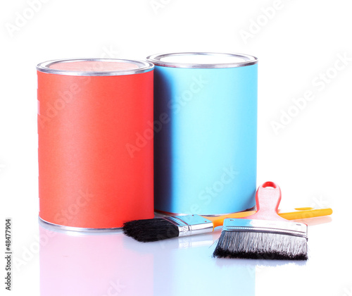 Cans of paint with paintbrushes isolated on white close-up
