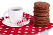 Chocolate cookies with creamy layer and cup of coffe isolated