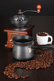 Fototapety Coffee maker and coffee mill on brown table