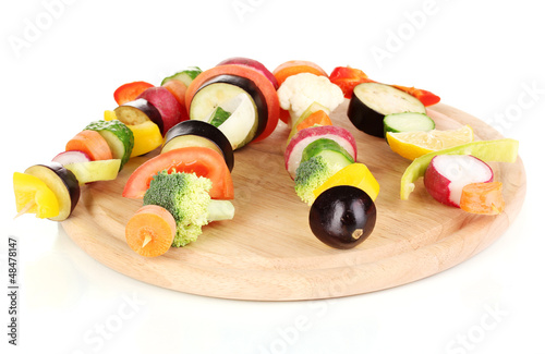 Sliced vegetables on wooden picks isolated on white
