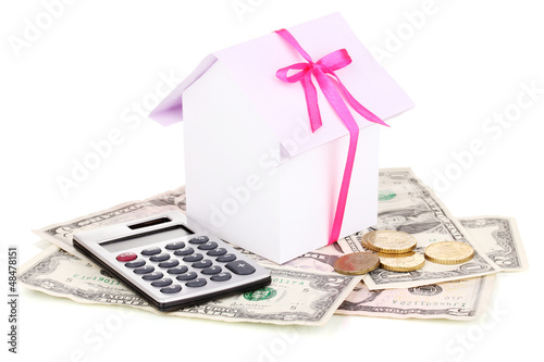 Small house and money isolated on white