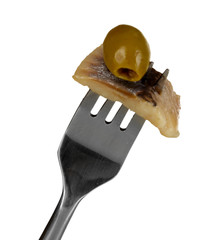 Piece of herring and olive on fork isolated on white