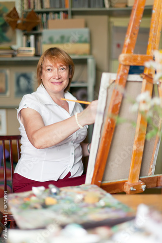 woman artist paints  on canvas