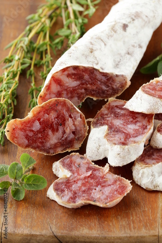 dried smoked sausage sliced ​​on board