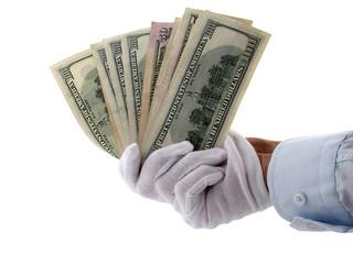 hand in gloves holding money