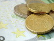 euro: coins lying on one hundred euro banknote