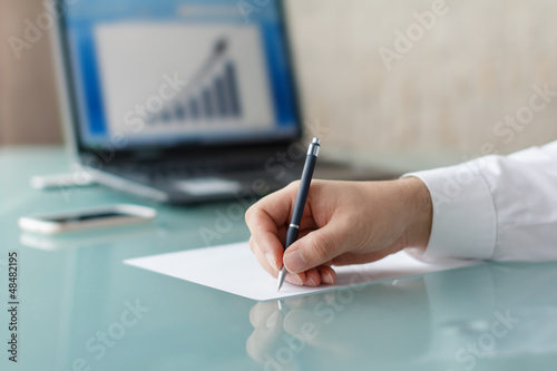 Businessman sign on white paper growth chart background