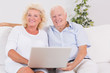 Old couple using a laptop together