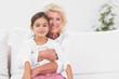 Smiling granddaughter and grandmother portrait