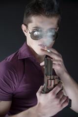 handsome man lights a cigarette