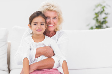 Smiling granddaughter and grandmother portrait