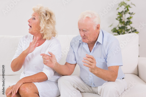 Elderly couple quarrelling