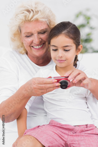 Granddaughter and grandmother looking at pictures