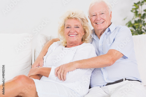 Joyful old couple portrait hugging