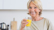 Mature woman drinking orange juice