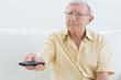 Elderly man using the remote