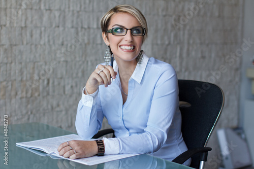 Blonde businesswoman with teeth smile