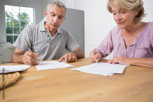 Couple signing documents together