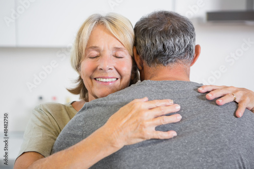 Joyful couple embracing