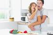 Husband and wife having fun in kitchen