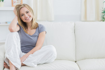 Portrait of relaxed woman sitting on couch