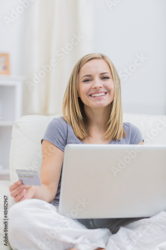 Portrait of casual woman doing online shopping at home