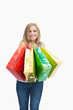 Portrait of cute young woman with shopping bags