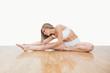 Young  woman in yoga pose on hardwood floor